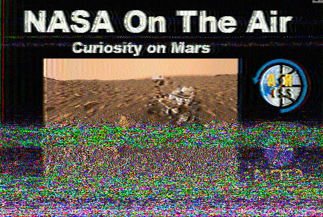 Image with a picture of Curiosity on Mars, captioned NASA On the Air - Curiosity on Mars ARISS