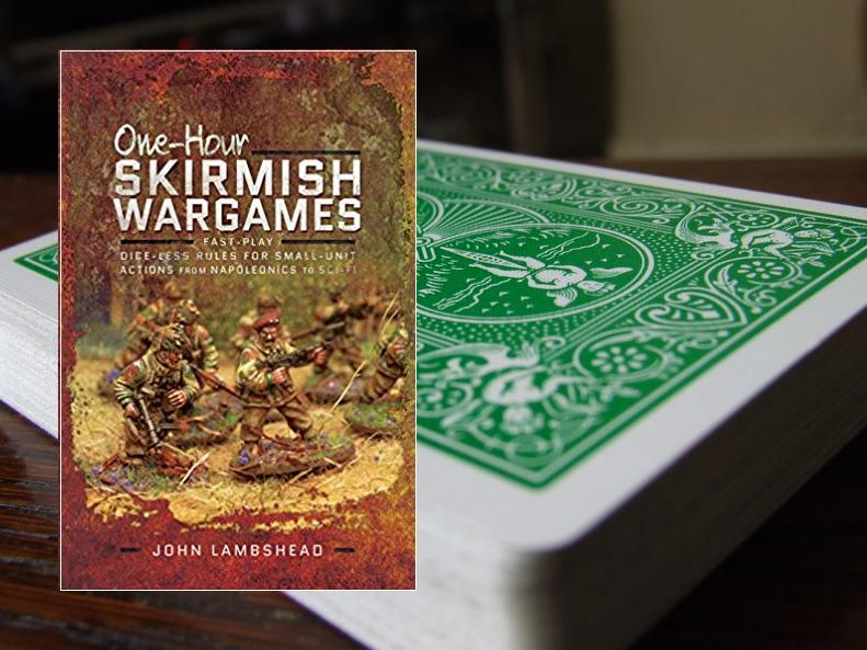 Photo of One Hour Skirmish Wargames book with playing cards in background