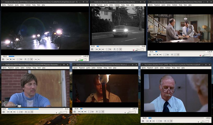 six different videos playing on a computer desktop