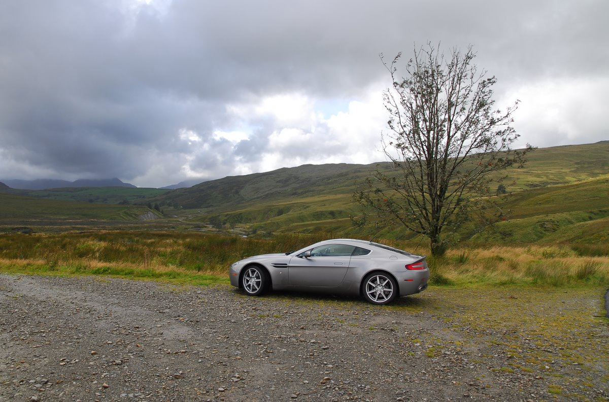 Aston Martin aside the road on a cloudy day